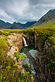 'Waterfall in Coire na Creiche (The Fairy Pools) near Glen Brittle with the hills of the Black Cuillin in the background; Isle of Skye, Scotland'