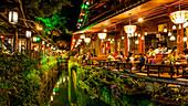 'Restaurant lights illuminated at night; Lijiang, Yunnan, China'