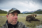 Photographer takes a selfie with a Grizzly bear near a salmon spawning stream, Katmai National Park, Southwest Alaska