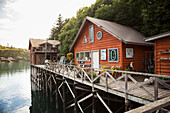 View of buildings along the boardwalk at Halibut Cove, Kachemak Bay, Southcentral Alaska.