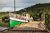 Crew members push off the Danny J to depart from Halibut Cove, Kachemak Bay, Southcentral Alaska