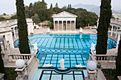 'A luxurious outdoor swimming pool with a view of the mountainous landscape; California, United States of America'