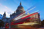 'St. Paul's Cathedral and light trails from a bus passing on the street in front; London, England'