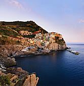 'Village of Manarola at sunset, Cinque Terre; Manarola, Liguria, Italy'