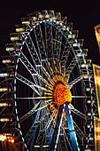 'Ferris wheel illuminated at nighttime; Munich, Germany'