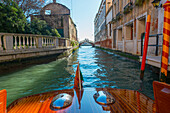 'Buildings along the shoreline of a canal viewed from a boat; Venice, Veneto, Italy'