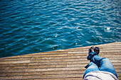 'Laying down on a wooden dock at the water's edge; Barcelona, Spain'