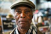 'Portrait of a senior man wearing a cap; London, England'