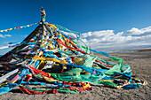 'Colourful Tibetan prayer flags (Lung ta) under the strong wind near Qinghai Lake; Qinghai province, Tibet'