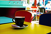 'A cup of coffee in a brightly coloured cafe, Marais district; Paris, France'