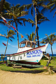 Hawaii, Maui, A fishing boat in front of Mama's Fish House restaurant on the north shore. EDITORIAL USE ONLY.