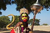 'Vijayanagara ruins, boy dressed as a Hunuman monkey god; Hampi, Karnataka, India'