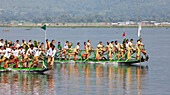 'Leg rowing procession on Inle Lake; Myanmar'