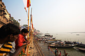 'Pilgrims at the ghats on the ganges; Varanasi, India'