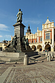 'Adam Mickiewicz Monument and Cloth Hall, Old Town Market Square; Krakow, Poland'