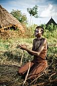 'Nuer woman preparing firewood, near Gambella, Western Ethiopia; Ethiopia'