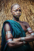 'Young Surma (Suri) woman with traditional face decoration, Southwest Ethiopia; Kibish, Ethiopia'