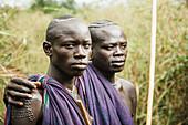 'Young Suri (Surma) men in village of Kibish, Omo region, Southwest Ethiopia; Kibish, Ethiopia'