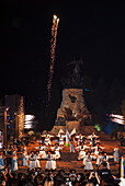 'Argentine folklore dance in front of monument; Mendoza, Argentina'