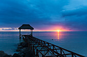 'Old abandoned pier at dusk; Republic of Mauritius'