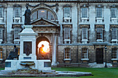 'Founders Fountain and the Gibbs Building of King's College at dusk; Cambridge, Cambridgeshire, England'