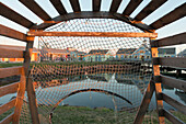 'View of Spinnakers Landing through a lobster trap; Summerside, Prince Edward Island, Canada'