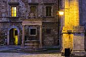 'Golden light illuminates walls on old renaissance buildings; Montepulciano, Tuscany, Italy'