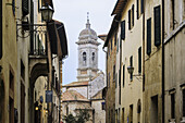 'Buildings and a bell tower; San Quirico d'Orcia, Tuscany, Italy'