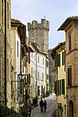'Residential buildings and a historic watchtower; Montalcino, Tuscany, Italy'
