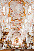 'Ornate interior and ceiling and centre aisle of a church; Bavaria, Germany'