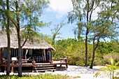 'A dwelling with thatch roof on the white sand; Vamizi Island, Mozambique'