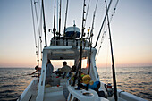'Fishing from a boat at sunset; Vamizi Island, Mozambique'