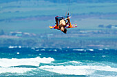 'Professional kiteboarder Niccolo Porcella kiteboarding on the north shore of Maui, Maui, Hawaii, United States of America'