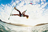 'Professional kiteboarder Susi Mai kitesurfing over the crystal blue waters, Necker Island, British Virgin Islands'