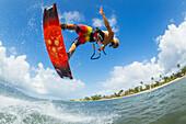 'Professional kiteboarder Niccolo Porcella kiteboarding on the South shore of Maui, Maui, Hawaii, United States of America'