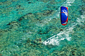 'Aerial view of a kiteboarder riding across the crystal clear blue waters, Anegada Island, British Virgin Islands'