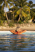 'Woman relaxing in a pool in the Caribbean; Barbados'