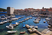 'Small boats and yachts moored in the harbour of the old walled city of Dubrovnik; Dalmatia region, Croatia'