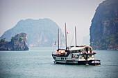 'Indochina junk in Bai Tu Long Bay in Halong Bay, Gulf of Tonkin; Cam Pha district, Vietnam'