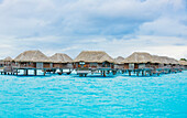 'Over-water bungalows at a tropical resort, Bora Bora, French Polynesia'