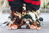 Feet of a performer under the costume of Barong, a mythical lion-like creature in a Barong dance performance in Batubulan, Bali, Indonesia