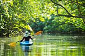 'Kayaking up the Faaroa River, Raiatea, French Polynesia'