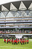 'Military band playing national anthem prior to Royal procession at the Parade Ring with new Enclosure stand at the world's best flat horse racing meeting, Royal Ascot; Ascot, Berkshire, England'