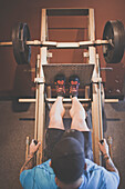 Adam Palmer, a mountain athlete, works out on the leg press at the gym.
