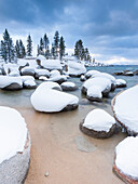 Fresh snow covers bolders at Sand Harbor, Lake Tahoe