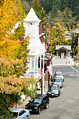 Historic Nevada City firehouse built in 1861 framed by fall leaves
