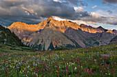 Sunset on Pyramid peak, one of Colorado's popular fourteeners, and a field of wildflowers on Buckskin pass near Aspen.