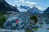 A man bouldering below Cerro Torre near Laguna Torre in Argentina's Los Glaciers National Park.