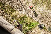 Lucas Iribarren bolting a new route in Premia's crag. Premia, Piemonte, Italy.