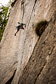 Climber falls while climbing a crack route using only traditional gear (friends and nuts) as protection. Esigo, Ossola, Italy.